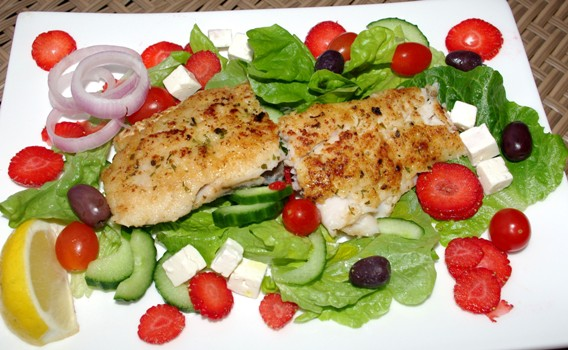 Hake with a Salad Hake fillet Lettuce Olives Low fat cottage cheese Onion Strawberries Fry the hake fillet in olive oil until golden brown. Add the salad ingredients and serve....